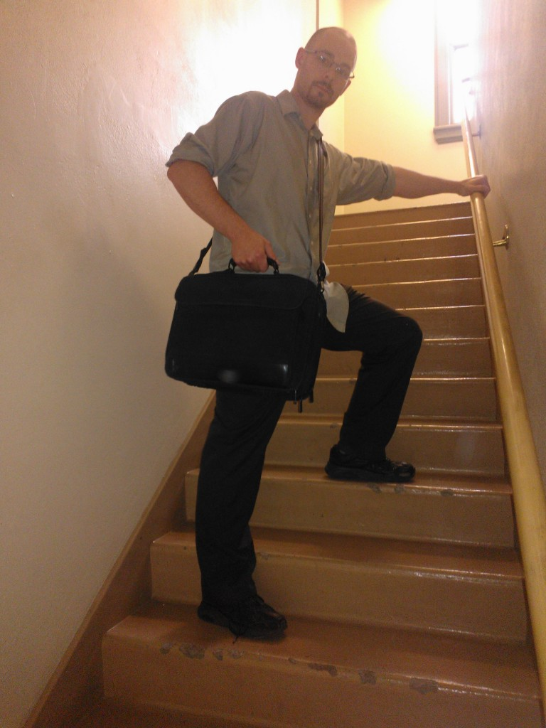 holding a bag on the way down stairs